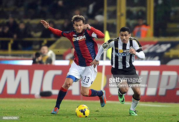 Alessandro Diamanti of Bologna FC competes the ball with Loureiro Allan of Udinese Calcio during the Serie A match between Bologna FC and Udinese...
