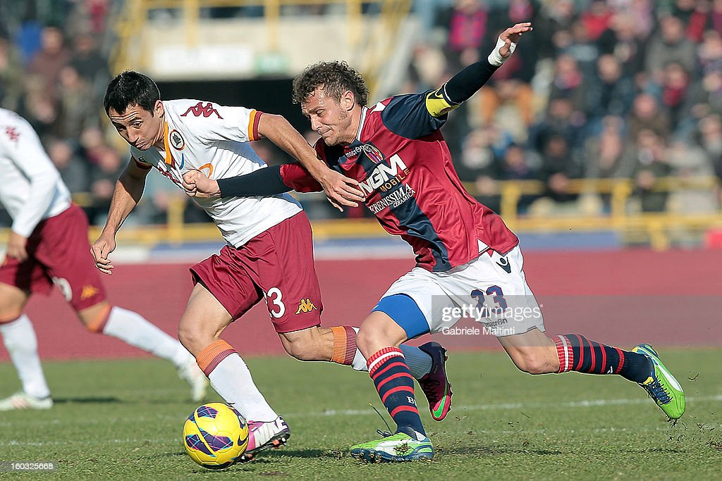 Alessandro Diamanti (R) of Bologna FC fights for the ball with Ivan Piris of AS Roma during the Serie A match between Bologna FC and AS Roma at Stadio Renato Dall'Ara on January 27, 2013 in Bologna, Italy.