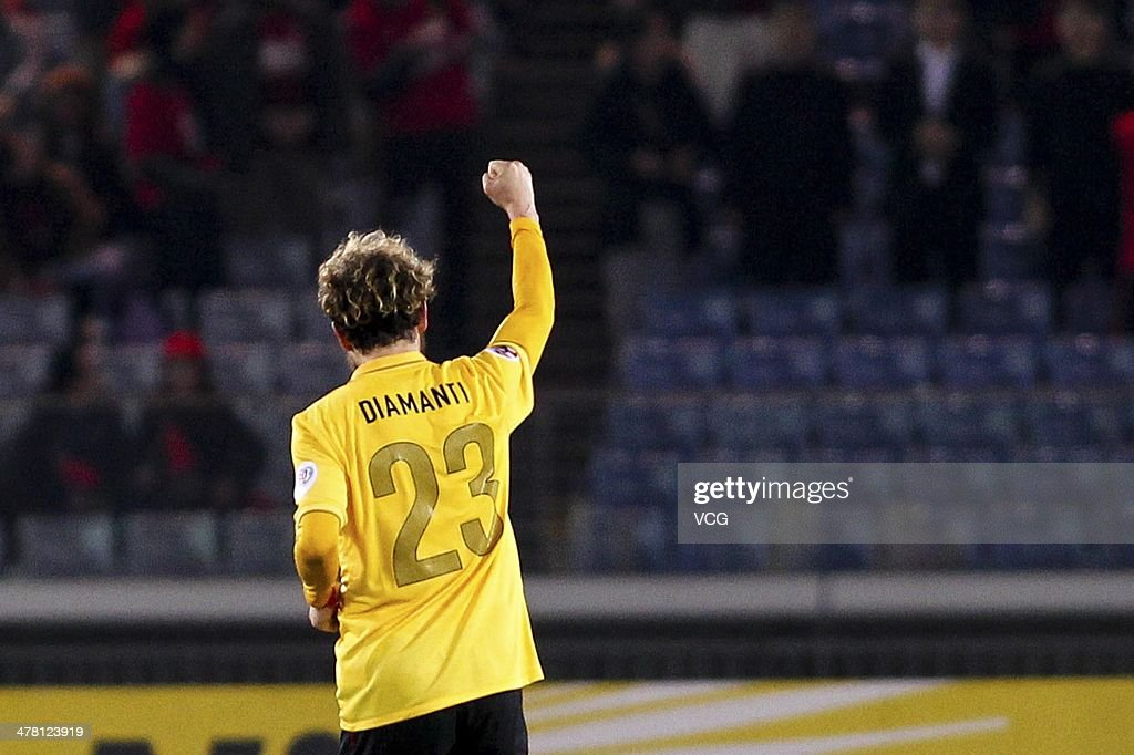 <a gi-track='captionPersonalityLinkClicked' href=/galleries/search?phrase=Alessandro+Diamanti&family=editorial&specificpeople=4891338 ng-click='$event.stopPropagation()'>Alessandro Diamanti</a> #23 of Guangzhou Evergrande celebrates after scoring the equalizer goal during the AFC Asian Champions League match between Yokohama F. Marinos and Guangzhou Evergrande at the Nissan Stadium on March 12, 2014 in Yokohama, Japan.
