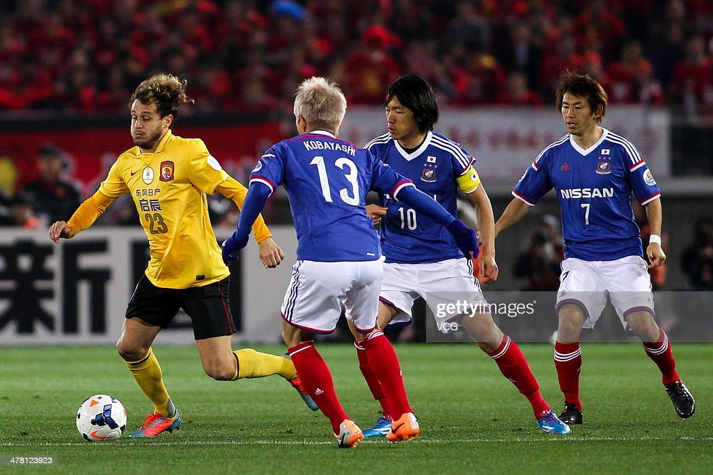 <a gi-track='captionPersonalityLinkClicked' href=/galleries/search?phrase=Alessandro+Diamanti&family=editorial&specificpeople=4891338 ng-click='$event.stopPropagation()'>Alessandro Diamanti</a> #23 of Guangzhou Evergrande is challenged by Yokohama F. Marinos players during the AFC Asian Champions League match between Yokohama F. Marinos and Guangzhou Evergrande at the Nissan Stadium on March 12, 2014 in Yokohama, Japan.