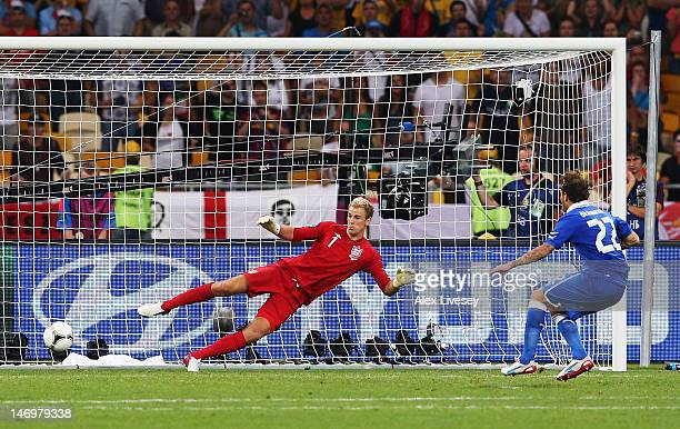 Alessandro Diamanti of Italy scores the winning penalty past Joe Hart of England during the UEFA EURO 2012 quarter final match between England and...
