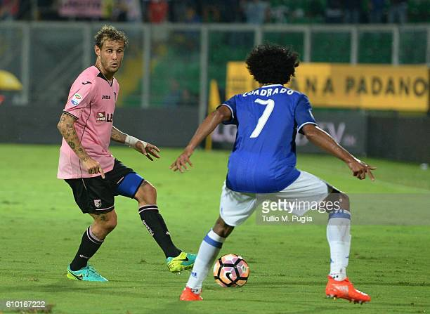 Alessandro Diamanti of Palermo and Juan Cuadrado of Juventus compete for the ball during the Serie A match between US Citta di Palermo and Juventus...