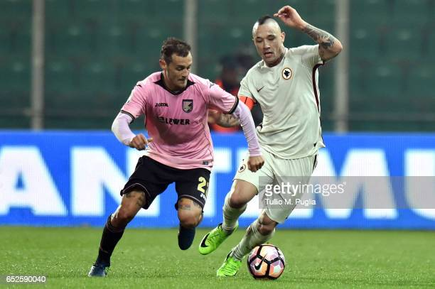 Alessandro Diamanti of Palermo is challenged by Radja Nainggolan of Roma during the Serie A match between US Citta di Palermo and AS Roma at Stadio...
