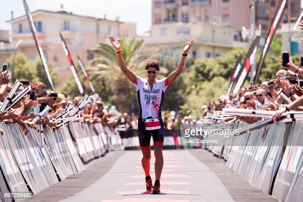 Alessandro Fabian of Italy celebrates as he finishes in 4th place Ironman 703 Italy race on June 18 2017 in Pescara Italy