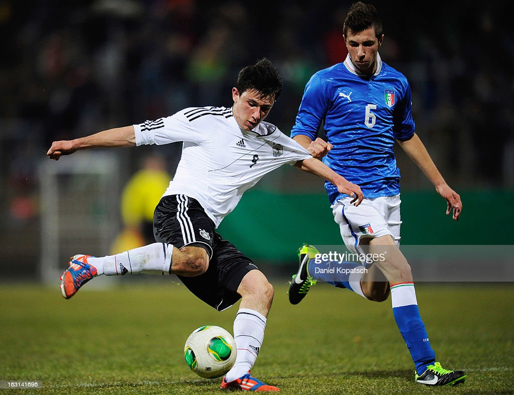 Alessandro Fiore Tapia of Germany (L) is challenged by Giorgio Piacentini of Italy during the U16 international friendly match between Germany and Italy on March 5, 2013 at Waldstadion in Homburg, Germany.