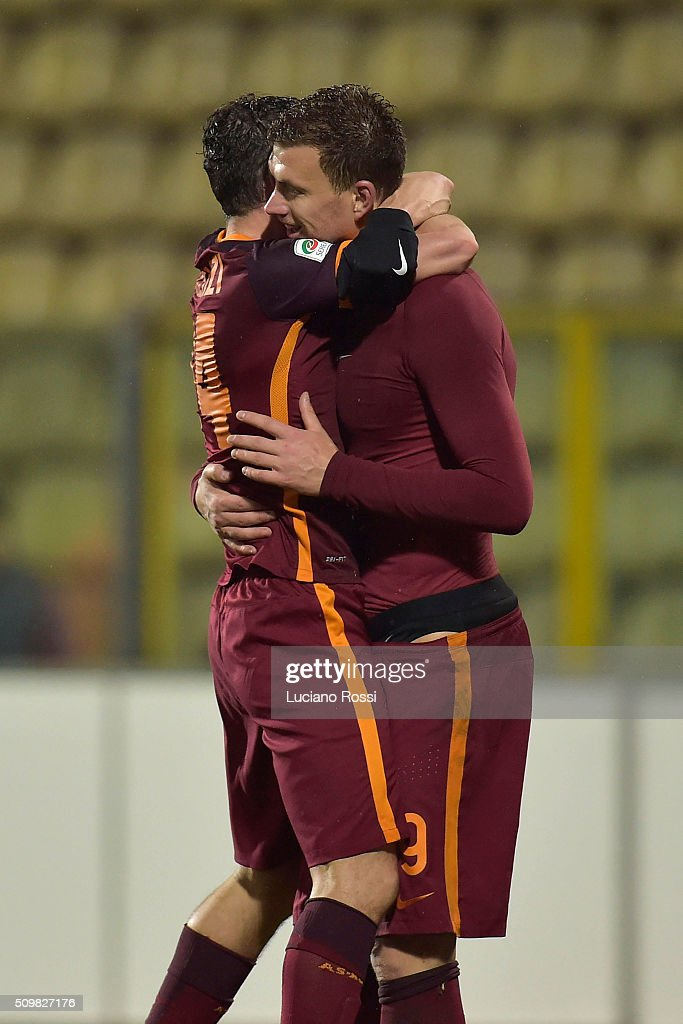 <a gi-track='captionPersonalityLinkClicked' href=/galleries/search?phrase=Alessandro+Florenzi&family=editorial&specificpeople=7349992 ng-click='$event.stopPropagation()'>Alessandro Florenzi</a> and <a gi-track='captionPersonalityLinkClicked' href=/galleries/search?phrase=Edin+Dzeko&family=editorial&specificpeople=4404455 ng-click='$event.stopPropagation()'>Edin Dzeko</a> of AS Roma celebrate the victory after the Serie A match between Carpi FC and AS Roma at Alberto Braglia Stadium on February 12, 2016 in Modena, Italy.