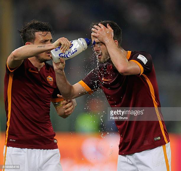 Alessandro Florenzi AS Roma sprays water on the face of Miralem Pjanic during the Serie A match between AS Roma and FC Internazionale Milano at...