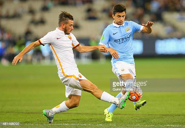 Alessandro Florenzi of AS Roma and Manu Garcia of Manchester City compete for the ball during the International Champions Cup friendly match between...
