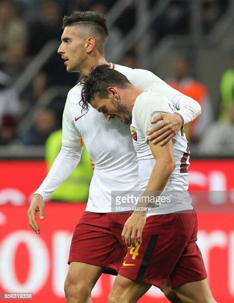 Alessandro Florenzi of AS Roma celebrates his goal with his teammate Lorenzo Pellegrini during the Serie A match between AC Milan and AS Roma at...