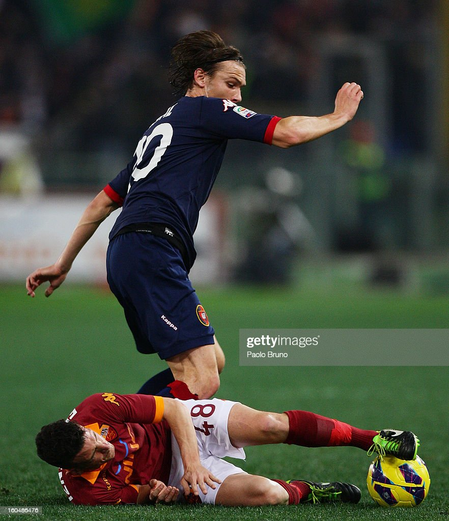 Alessandro Florenzi #48 of AS Roma competes for the ball with Albin Ekdal of Cagliari Calcio during the Serie A match between AS Roma and Cagliari Calcio at Stadio Olimpico on February 1, 2013 in Rome, Italy.