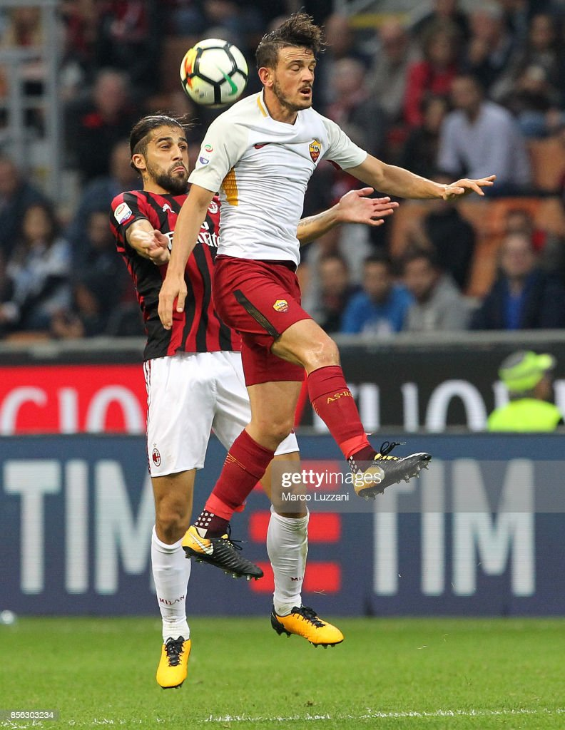 Alessandro Florenzi (R) of AS Roma competes for the ball with Ricardo Rodriguez of AC Milan during the Serie A match between AC Milan and AS Roma at Stadio Giuseppe Meazza on October 1, 2017 in Milan, Italy.
