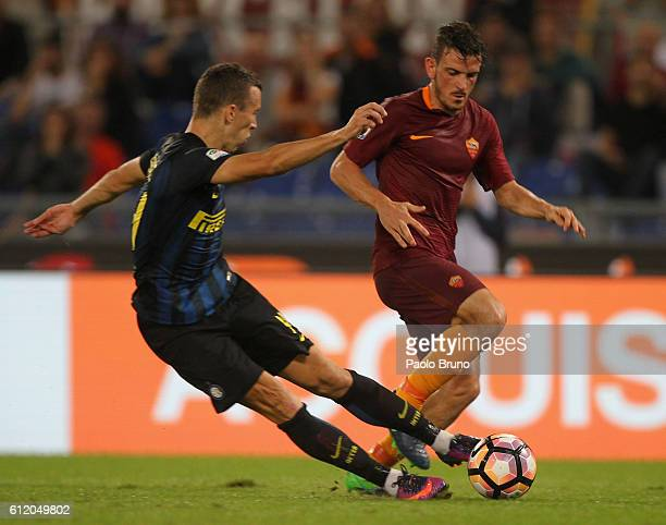 Alessandro Florenzi of AS Roma in action as Ivan Perisic of FC Internazionale kicks the ball during the Serie A match between AS Roma and FC...