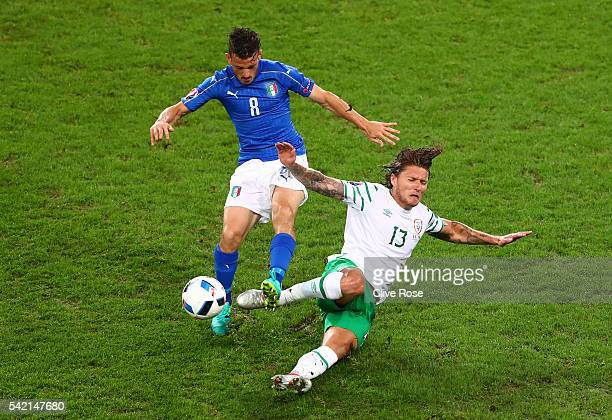Alessandro Florenzi of Italy and Jeff Hendrick of Republic of Ireland compete for the ball during the UEFA EURO 2016 Group E match between Italy and...