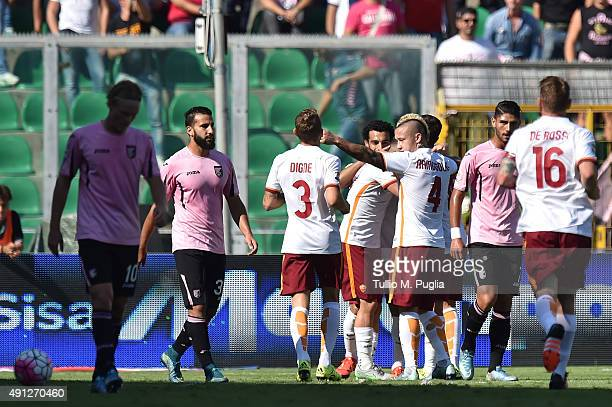 Alessandro Florenzi of Roma celebrates with team mates after scoring his team's second goal during the Serie A match between US Citta di Palermo and...