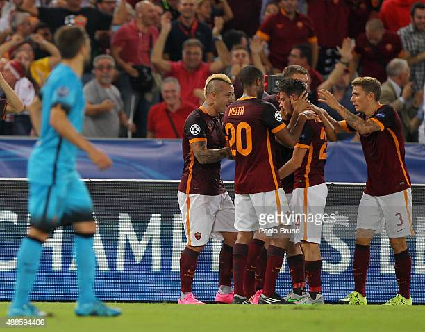 Alessandro Florenzi with his teammates of AS Roma celebrates after scoring the team's first goal during the UEFA Champions League Group E match...
