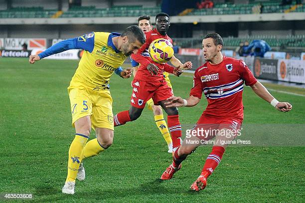 Alessandro Gamberini of AC Chievo Verona competes the ball with Djamel Mesbah of UC Sampdoria during the Serie A match between AC Chievo Verona and...