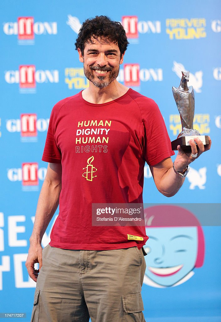<a gi-track='captionPersonalityLinkClicked' href=/galleries/search?phrase=Alessandro+Gassman&family=editorial&specificpeople=2855774 ng-click='$event.stopPropagation()'>Alessandro Gassman</a> poses with the Giffoni Award during 2013 Giffoni Film Festival on July 28, 2013 in Giffoni Valle Piana, Italy.