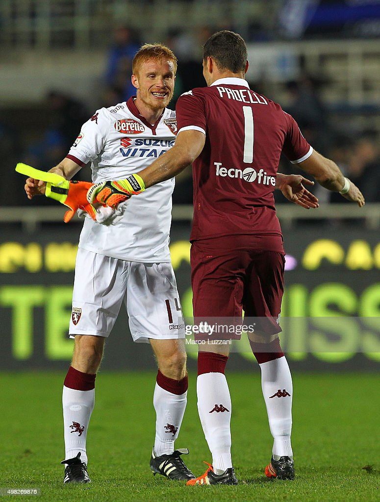 Alessandro Gazzi and Daniele Padelli of Torino FC celebrate a victory at the end of the Serie A match between Atalanta BC and Torino FC at Stadio Atleti Azzurri d'Italia on November 22, 2015 in Bergamo, Italy.
