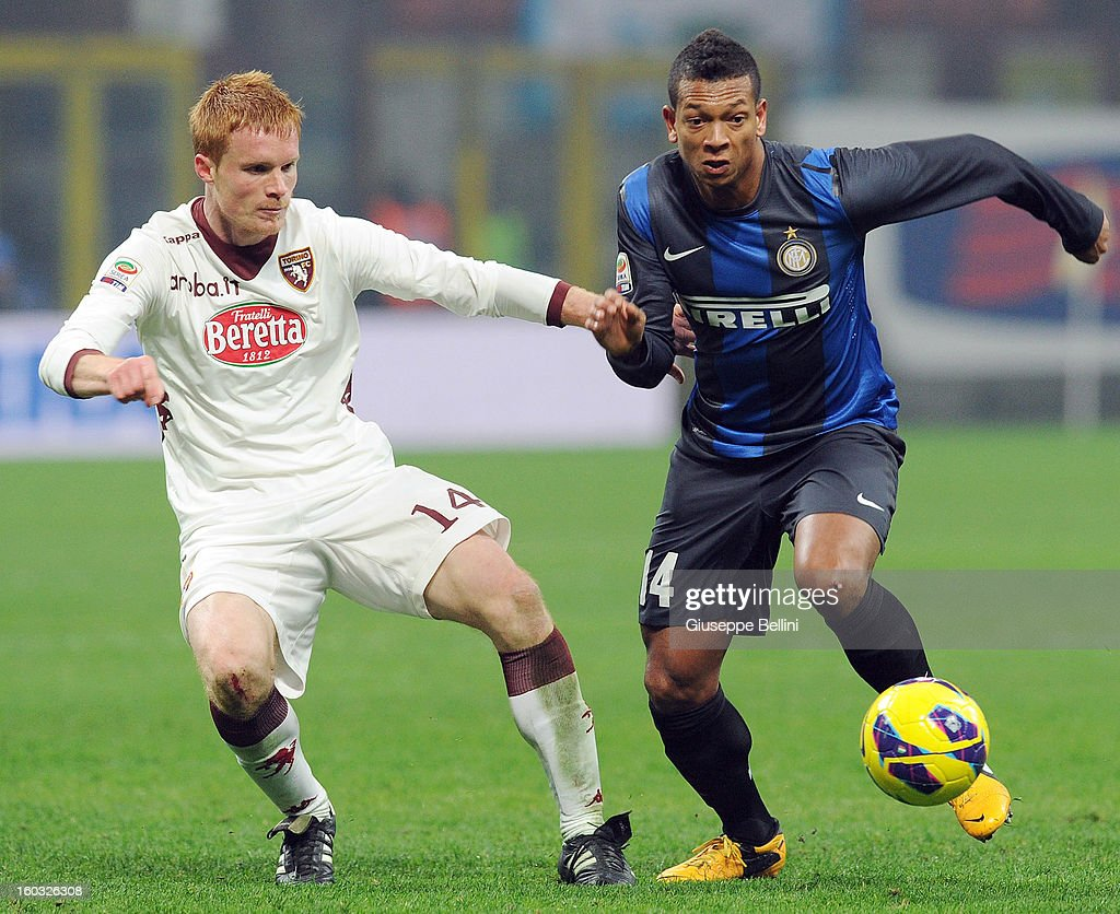 Alessandro Gazzi (L) of Torino challenges Fredy Guarin of Inter during the Serie A match between FC Internazionale Milano and Torino FC at San Siro Stadium on January 27, 2013 in Milan, Italy.