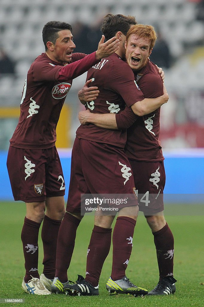 Alessandro Gazzi (R) of Torino FC celebrates with his team-mates after scoring during the Serie A match between Torino FC and AC Chievo Verona at Stadio Olimpico di Torino on December 22, 2012 in Turin, Italy.