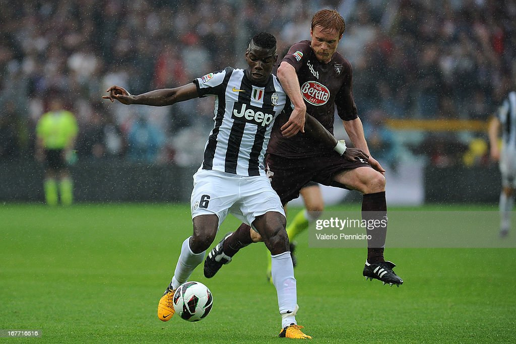 Alessandro Gazzi (R) of Torino FC competes with <a gi-track='captionPersonalityLinkClicked' href=/galleries/search?phrase=Paul+Pogba&family=editorial&specificpeople=5805302 ng-click='$event.stopPropagation()'>Paul Pogba</a> of Juventus during the Serie A match between Torino FC and Juventus at Stadio Olimpico di Torino on April 28, 2013 in Turin, Italy.