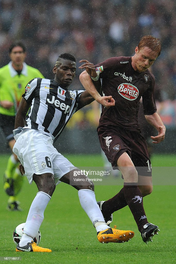 Alessandro Gazzi (R) of Torino FC competes with Paul Pogba of Juventus during the Serie A match between Torino FC and Juventus at Stadio Olimpico di Torino on April 28, 2013 in Turin, Italy.
