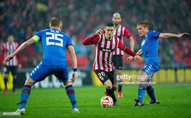 Alessandro Gazzi of Torino FC duels for the ball with Aritz Aduriz of Athletic Club during the UEFA Europa League Round of 32 match between Athletic...