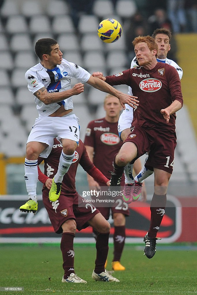 Alessandro Gazzi (R) of Torino FC goes up with <a gi-track='captionPersonalityLinkClicked' href=/galleries/search?phrase=Carlos+Carmona&family=editorial&specificpeople=3035631 ng-click='$event.stopPropagation()'>Carlos Carmona</a> of Atalanta BC during the Serie A match between Torino FC and Atalanta BC at Stadio Olimpico di Torino on February 17, 2013 in Turin, Italy.