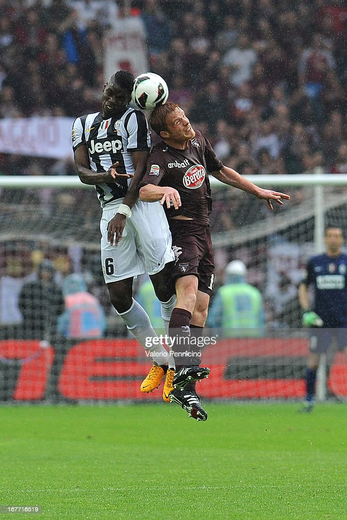 Alessandro Gazzi (R) of Torino FC goes up with Paul Pogba of Juventus during the Serie A match between Torino FC and Juventus at Stadio Olimpico di Torino on April 28, 2013 in Turin, Italy.