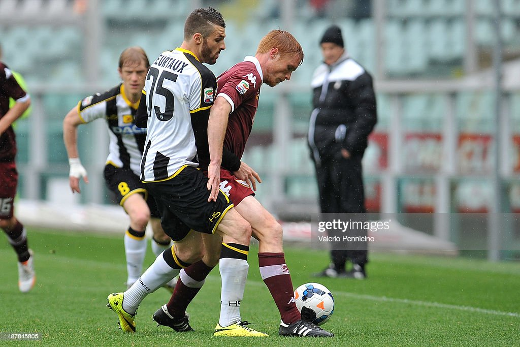 Alessandro Gazzi (R) of Torino FC is challenged by <a gi-track='captionPersonalityLinkClicked' href=/galleries/search?phrase=Thomas+Heurtaux&family=editorial&specificpeople=7140770 ng-click='$event.stopPropagation()'>Thomas Heurtaux</a> of Udinese Calcio during the Serie A match between Torino FC and Udinese Calcio at Stadio Olimpico di Torino on April 27, 2014 in Turin, Italy.