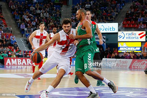 Alessandro Gentile #5 of EA7 Emporio Armani Milan competes with Adam Hanga #8 of Laboral Kutxa Vitoria Gasteiz during the Turkish Airlines Euroleague...