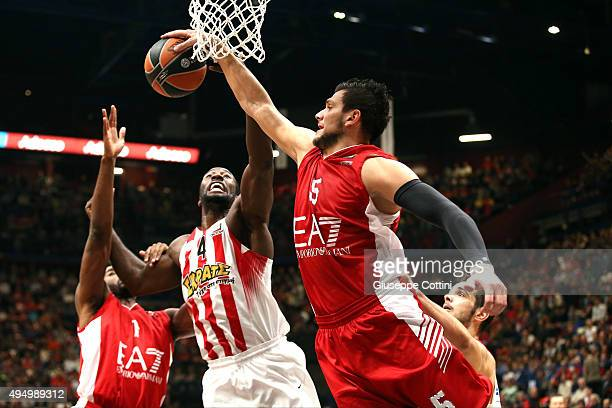 Alessandro Gentile #5 of EA7 Emporio Armani Milan competes with Patrick Young #4 of Olympiacos Piraeus during the Turkish Airlines Euroleague Regular...