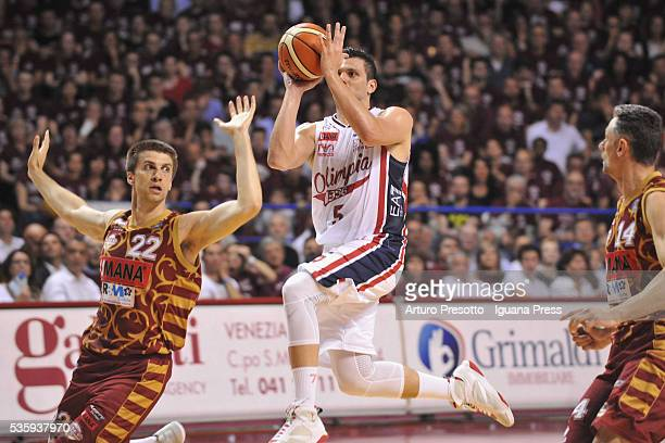 Alessandro Gentile of EA7 competes with Jeff Viggiano and Tomas Ress of Umana during the LegaBsaket Serie A match between Reyer Umana Venezia and EA7...