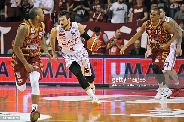 Alessandro Gentile of EA7 competes with Phil Goss and Josh Owens of Umana during the LegaBsaket Serie A match between Reyer Umana Venezia and EA7...