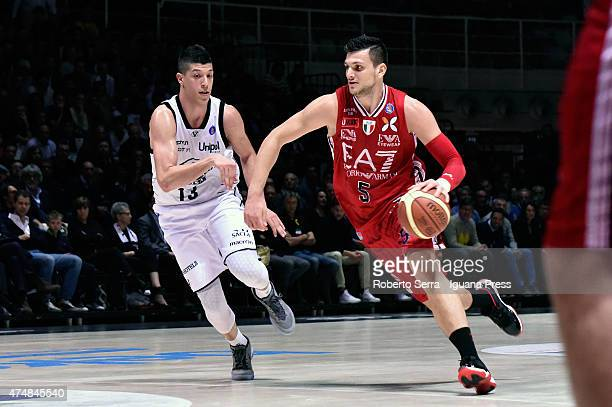 Alessandro Gentile of EA7 competes with Simone Fontecchio of Granarolo during the LegaBasket Serie A1 match between Virtus Granarolo Bologna and...