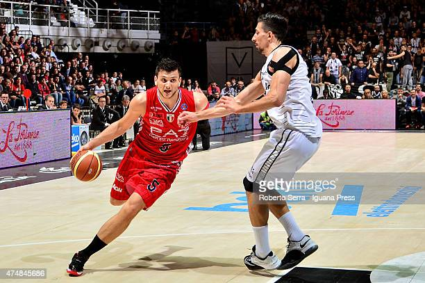 Alessandro Gentile of EA7 competes with Valerio Mazzola of Granarolo during the LegaBasket Serie A1 match between Virtus Granarolo Bologna and...