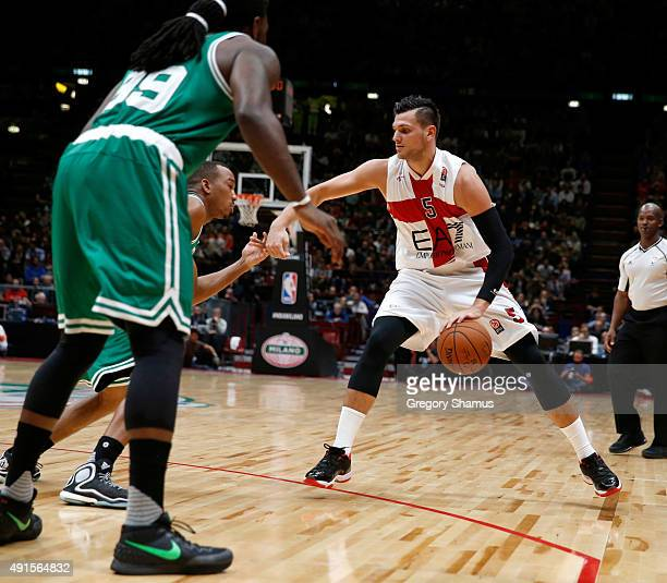 Alessandro Gentile of Emporio Armani Milano dribbles against the Boston Celtics as part of the 2015 Global Games on October 6 2015 at the Mediolanum...