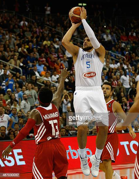 Alessandro Gentile of Italy drives to the basket against Ali Muhammed of Turkey during the FIBA EuroBasket 2015 Group B basketball match between...