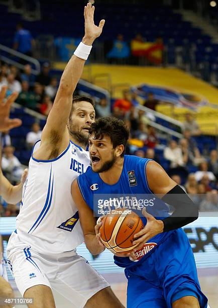 Alessandro Gentile of Italy drives to the basket against Hlynur Baeringsson of Iceland during the FIBA EuroBasket 2015 Group B basketball match...
