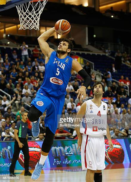 Alessandro Gentile of Italy drives to the basket against Milos Teodosic of Serbia during the FIBA EuroBasket 2015 Group B basketball match between...