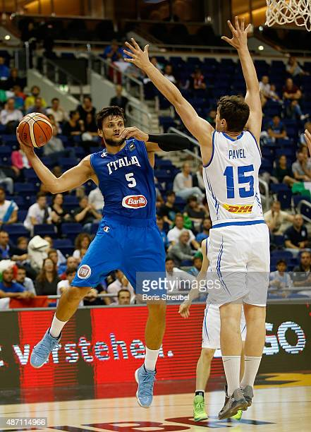 Alessandro Gentile of Italy drives to the basket against Pavel Ermolinskij of Iceland during the FIBA EuroBasket 2015 Group B basketball match...