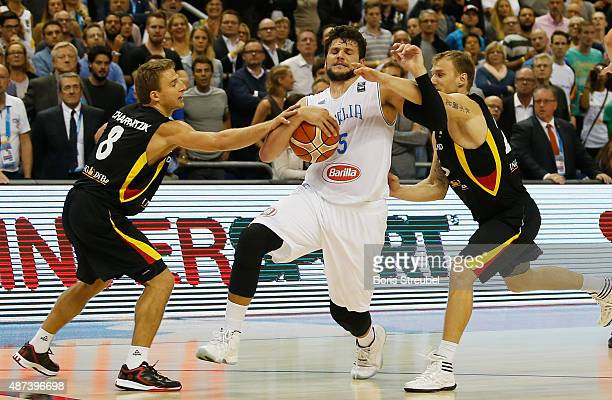 Alessandro Gentile of Italy is blocked by Heiko Schaffartzik of Germany during the FIBA EuroBasket 2015 Group B basketball match between Italy and...