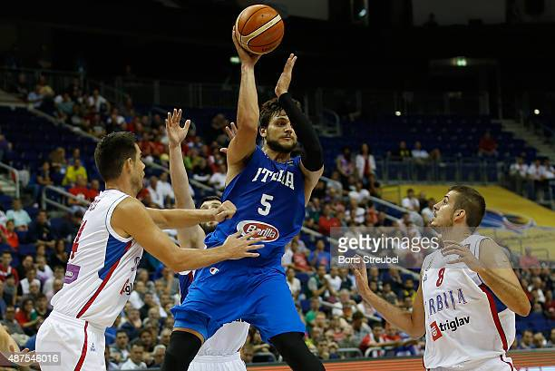 Alessandro Gentile of Italy jumps to pass the ball against Serbia during the FIBA EuroBasket 2015 Group B basketball match between Serbia and Italy...