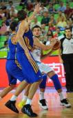 Alessandro Gentile of Italy vies with Viacheslav Kravtsov and Maksym Pustozvonov of Ukraine during their FIBA Eurobasket 58 place classification...