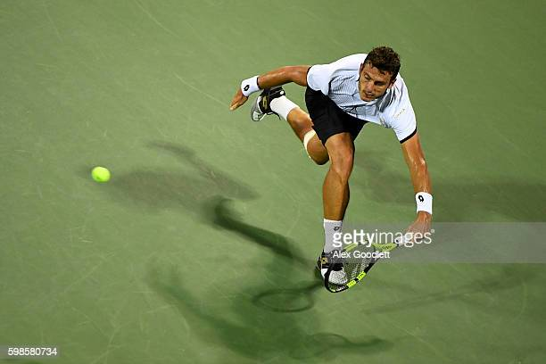 Alessandro Giannessi of Italy returns a shot to Stan Wawrinka of Switzerland during his second round Men's Singles match on Day Four of the 2016 US...