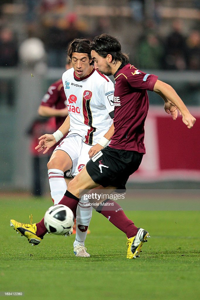 Alessandro Lambrughi of AS Livorno battles for the ball with Angelo Antonazzo of Reggina Calcio during the Serie B match between AS Livorno and Reggina Calcio at Stadio Armando Picchi on March 9, 2013 in Livorno, Italy.