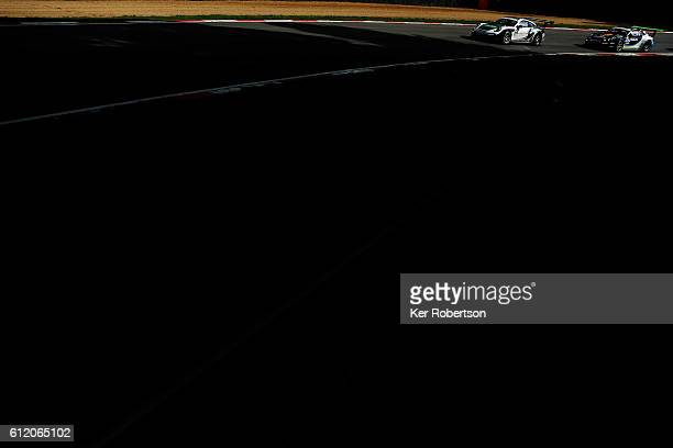 Alessandro Latif of GT Marques and Tom Oliphant of Team Redline drive during the Porsche Carrera Cup at Brands Hatch on October 2 2016 in Longfield...