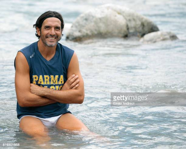 Alessandro Lucarelli of Parma Calcio 1913 smiles sitting in the river at the end of the Parma Calcio 1913 training session on July 20 2017 in Pinzolo...