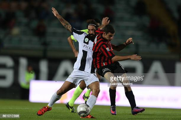 Alessandro Marotta of Robur Siena battles for the ball with Gianluca Barba of Pro Piacenza during the Serie A match between Robur Siena and Pro...