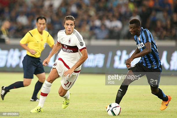 Alessandro Matri of AC Milan and Assane Demoya Gnoukouri of Inter Milan compete for the ball during the International Champions Cup match between AC...